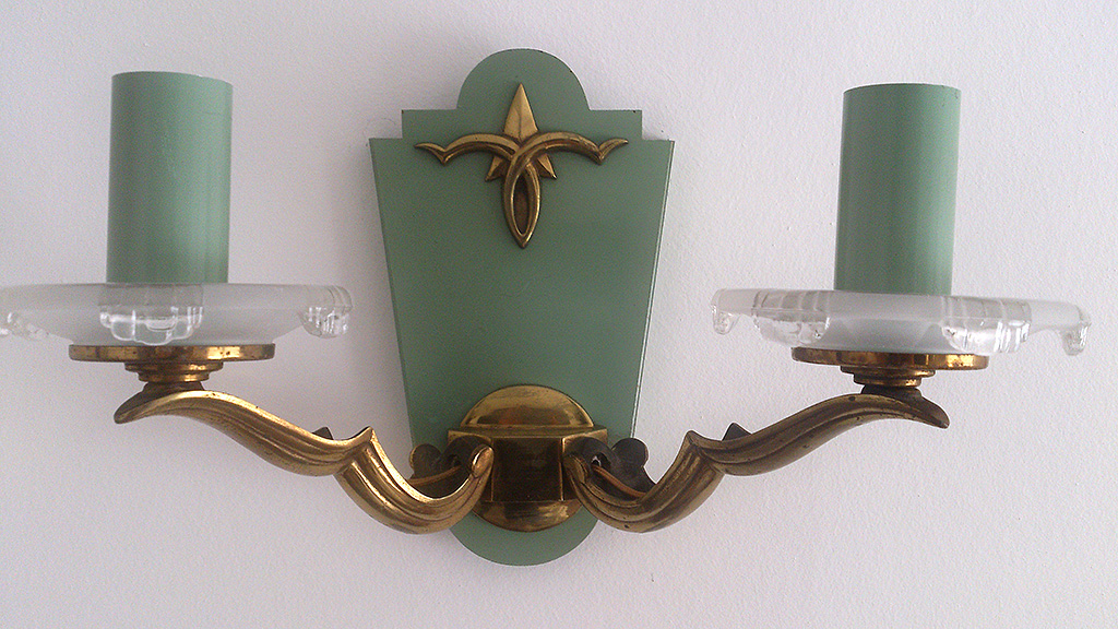 1940's suite of three brass steel sconces