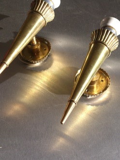 an unusual pair of French 1940 solid brass in the style of Genet and Michon